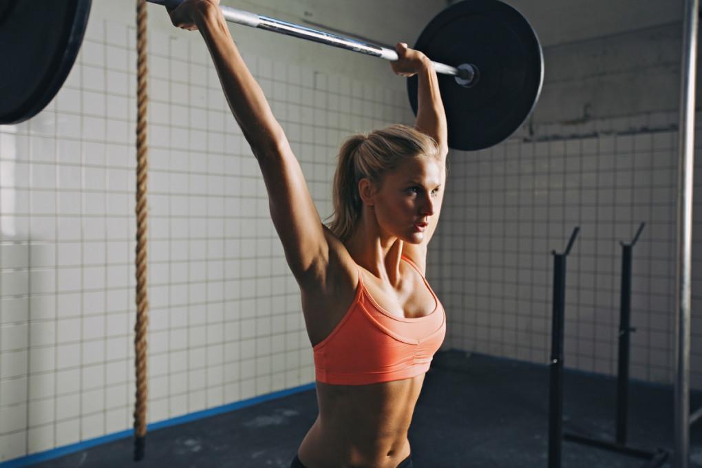 Woman Doing Barbell Lifting