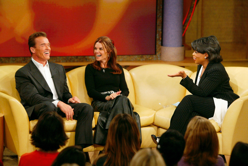 "CHICAGO, IL - SEPTEMBER 15:  In this handout photo, actor and California gubernatorial candidate Arnold Schwarzenegger (L) and his wife Maria Shriver appear live on ""The Oprah Winfrey Show's"" season premiere September 15, 2003 in Chicago, Illinois. It is their first interview together as a couple since he announced his bid for governor of California.  (Photo by George Burns/Harpo Productions via Getty Images)"